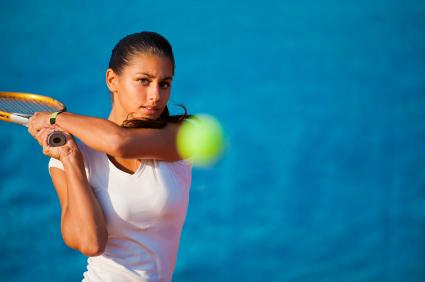 Beautiful-Young-Woman-Playing-Tennis
